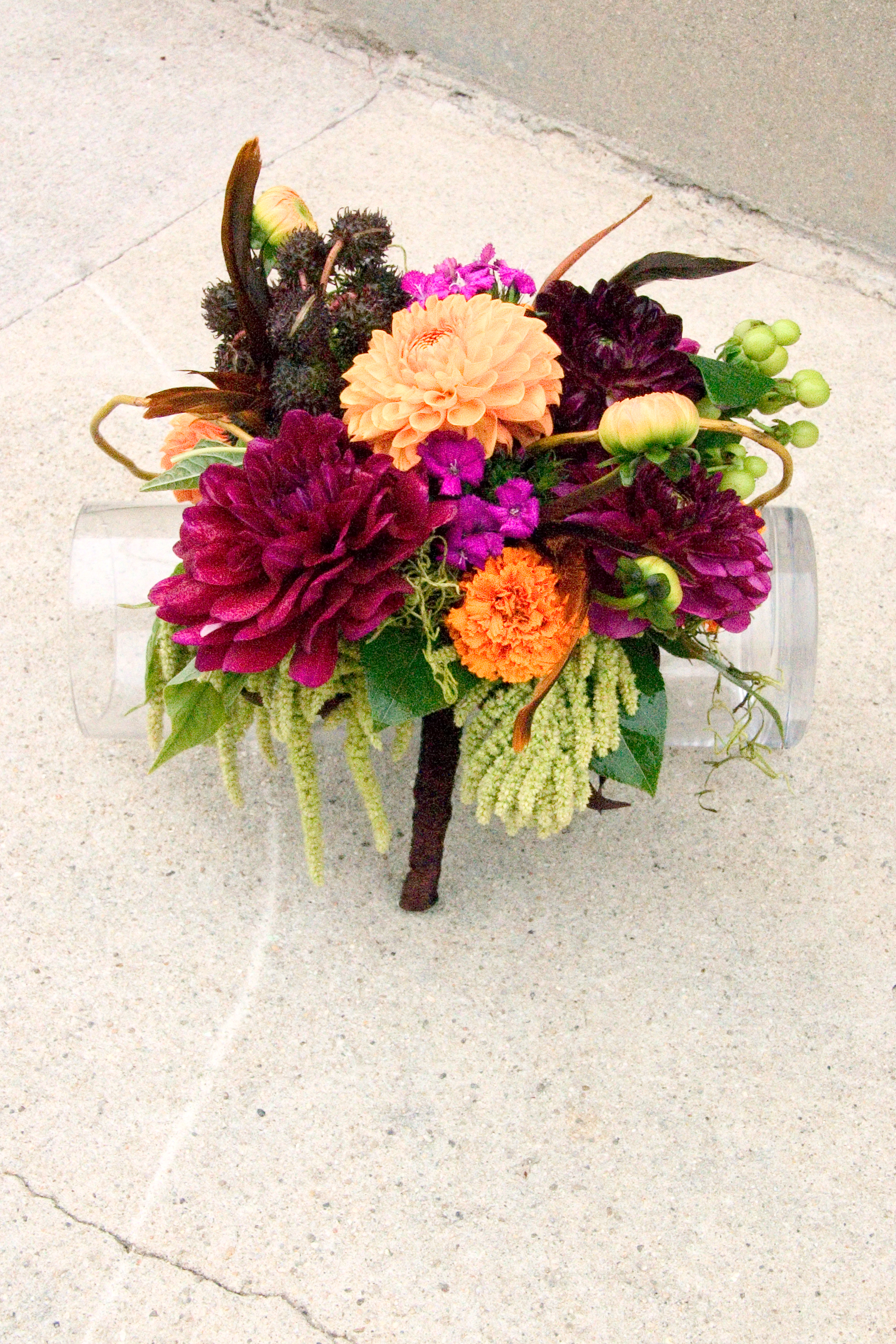 Feather And Jewel Tone Wedding Flowers