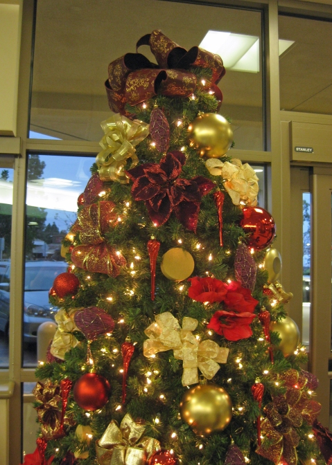 The main focus of the tree is the lobby bows created from various gold and burgundy ribbons. There are almost 30 bows including a large oversized Burgundy bow for the tree topper. There were also some amazing teardrop shaped ornaments.