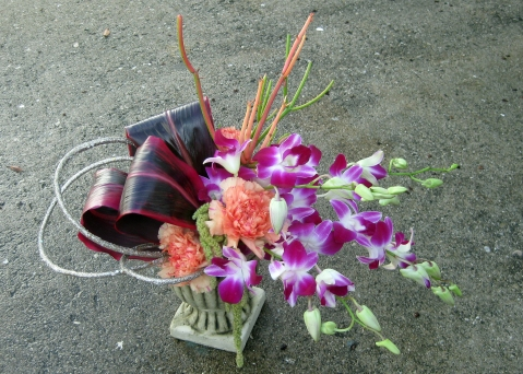 Stylized with orchids, ti leaves, succulents - Floral Design By Jacqueline Ahne